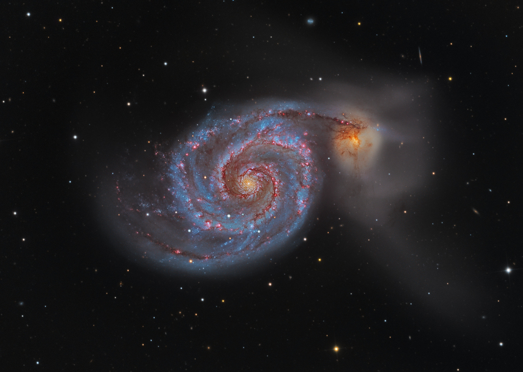 The Whirlpool Galaxy. It's spiral structure was discovered by the Earl of Rosse with his backyard telescope in 1845.