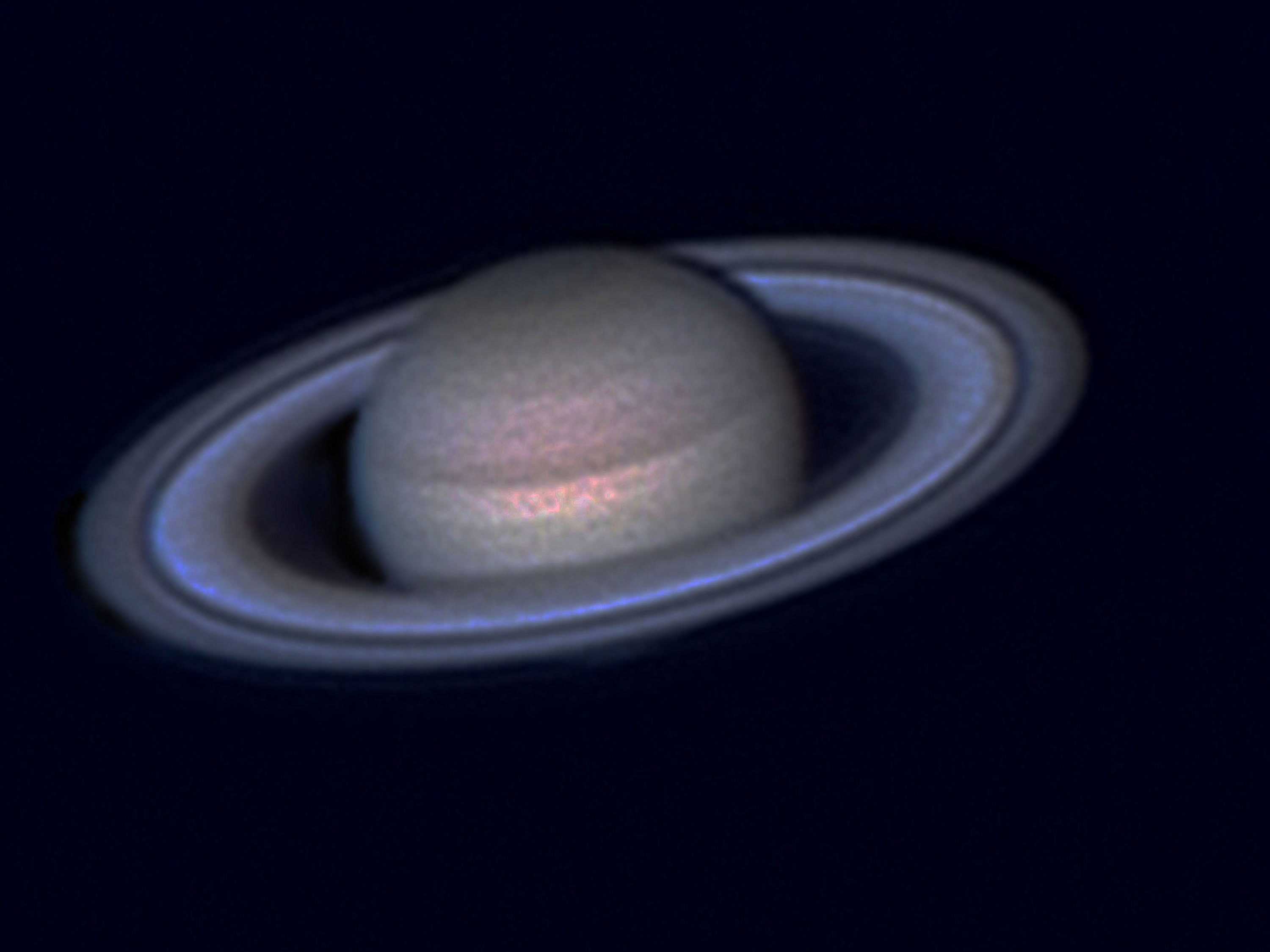 Saturn as it appears through a telescope
